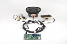 Turnkey audio system for casino gaming consoles including speakers amplifier subwoofer and wiring harness MISCO model TK-301