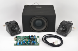 Turnkey audio system for casino gaming consoles including speakers amplifier subwoofer and wiring harness MISCO model TK-401